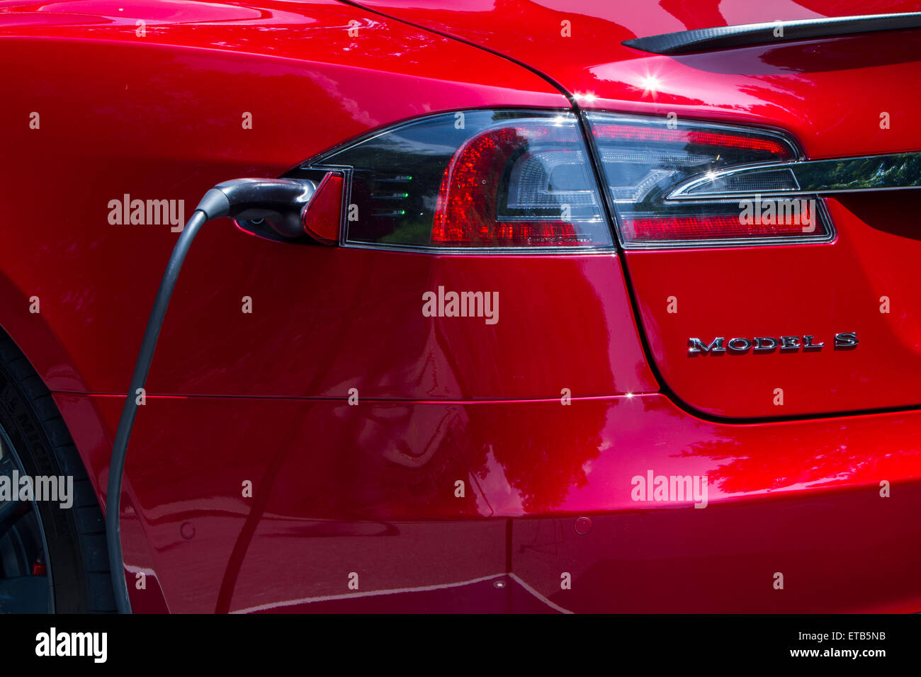 Turin, Italy, 11th June 2015. A Tesla Model S charging. Parco Valentino car show hosted 93 cars by many automobile - Stock Image