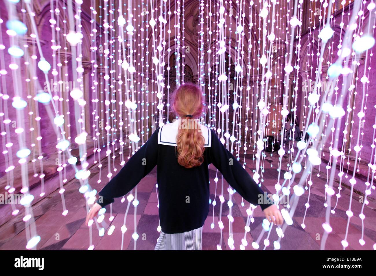 Salisbury, Wiltshire, UK. 12th June, 2015. A schoolgirl passes through an installation titled ENLIGHTENMENT in the - Stock Image