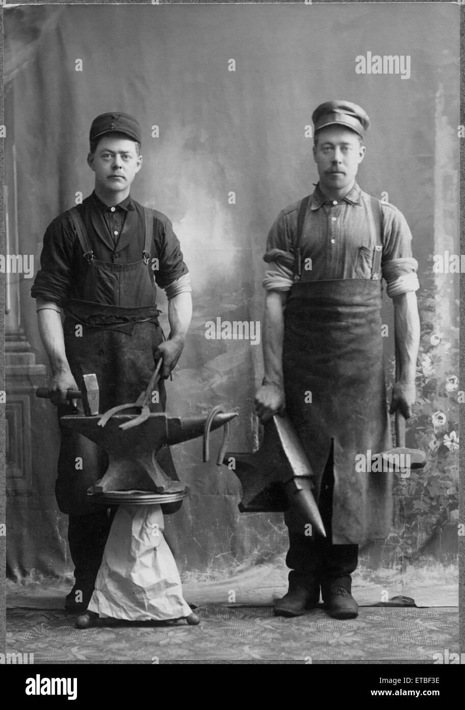 Two Blacksmiths, Portrait, circa 1900 - Stock Image