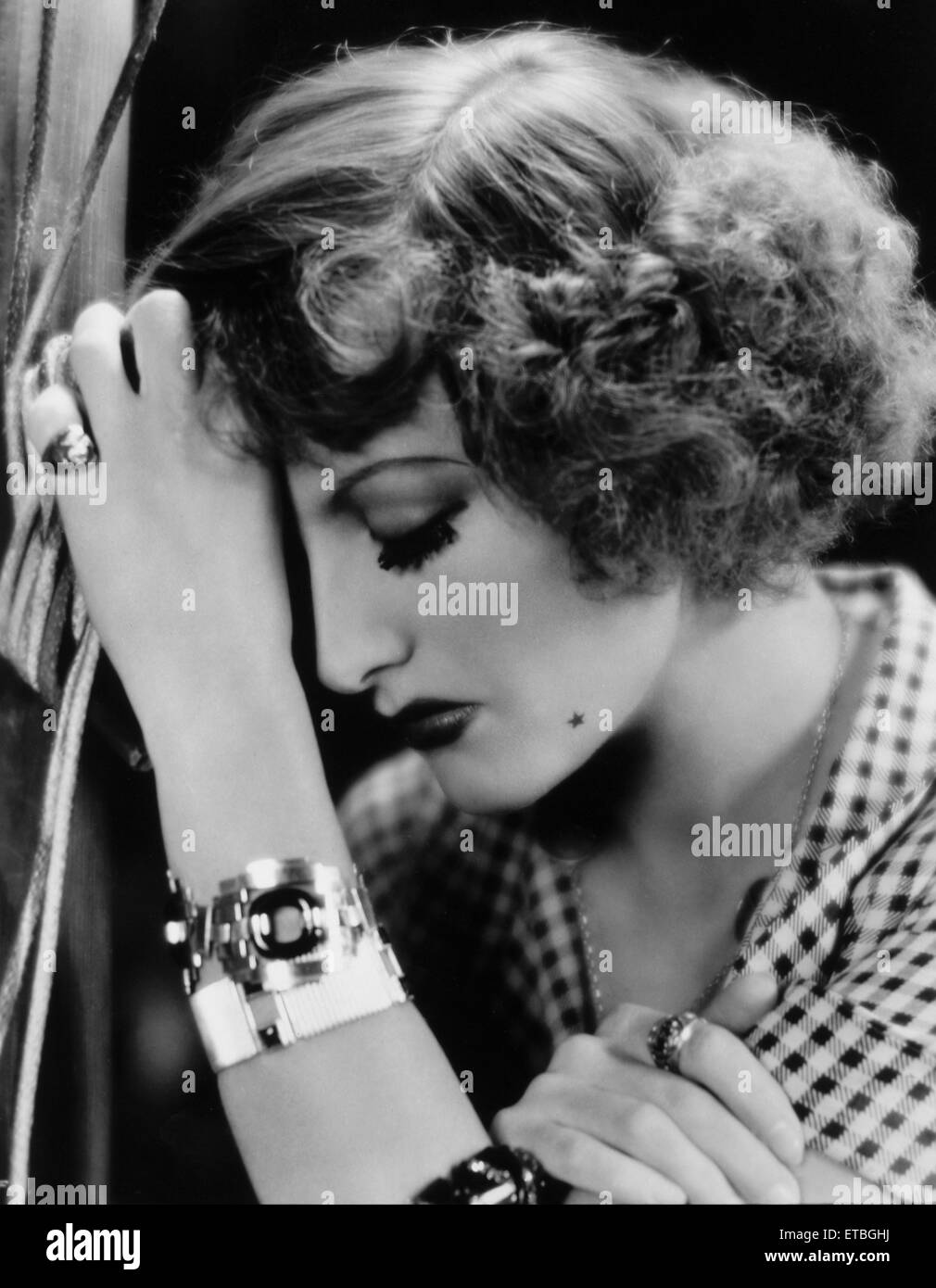 Joan Crawford, on-set of the Film, 'Rain' Directed by Lewis Milestone, 1932 - Stock Image