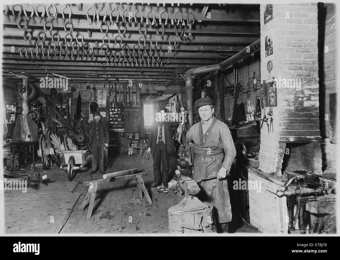 Blacksmith in Cartwright shop, circa 1890 - Stock Image