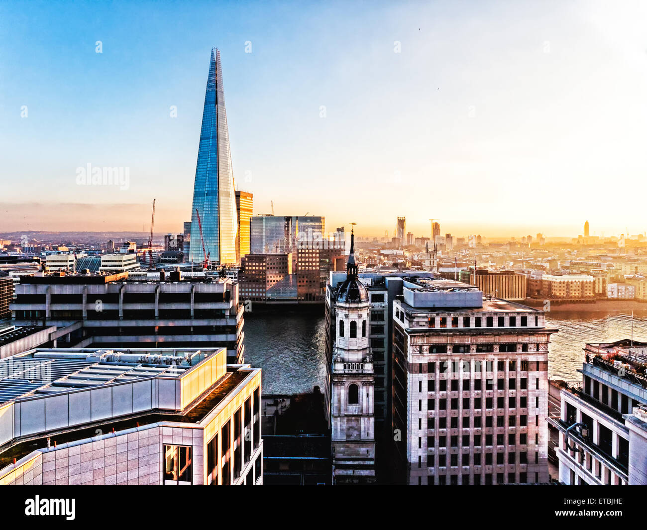 Aerial the new London skyline with The Shard, Thames River and the skyscrapers of the City - Stock Image