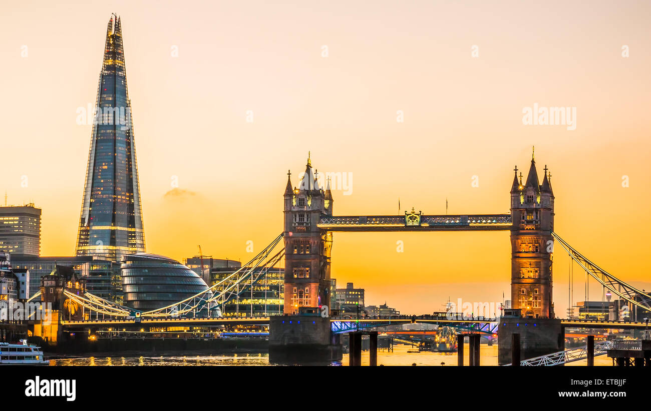 The new London skyline with Tower Bridge and the new The Shard skyscraper at Dusk. - Stock Image