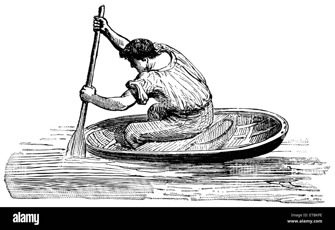 Man Paddling Coracle, Wales, 'Classical Portfolio of Primitive Carriers', by Marshall M. Kirman, World Railway - Stock Image