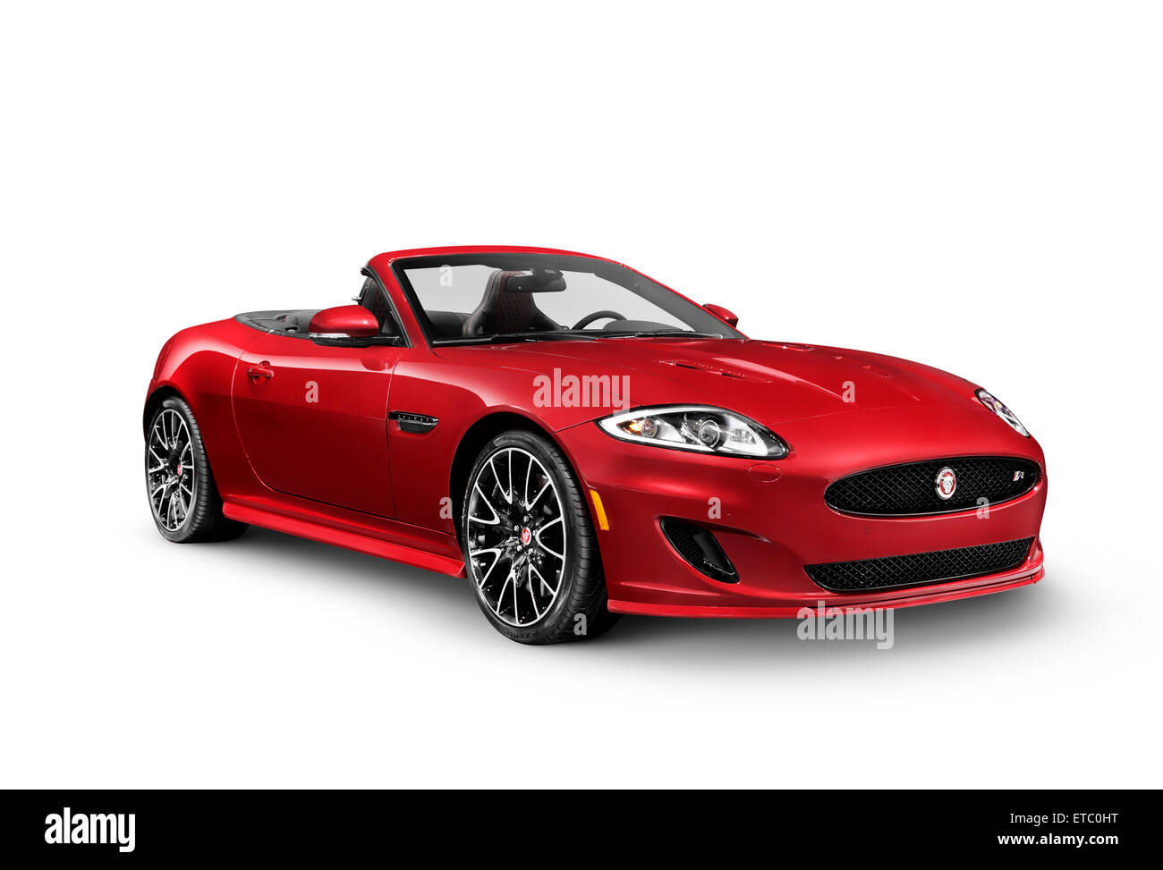 Red 2014 Jaguar XKR convertible luxury sports car isolated on white background with clipping path - Stock Image
