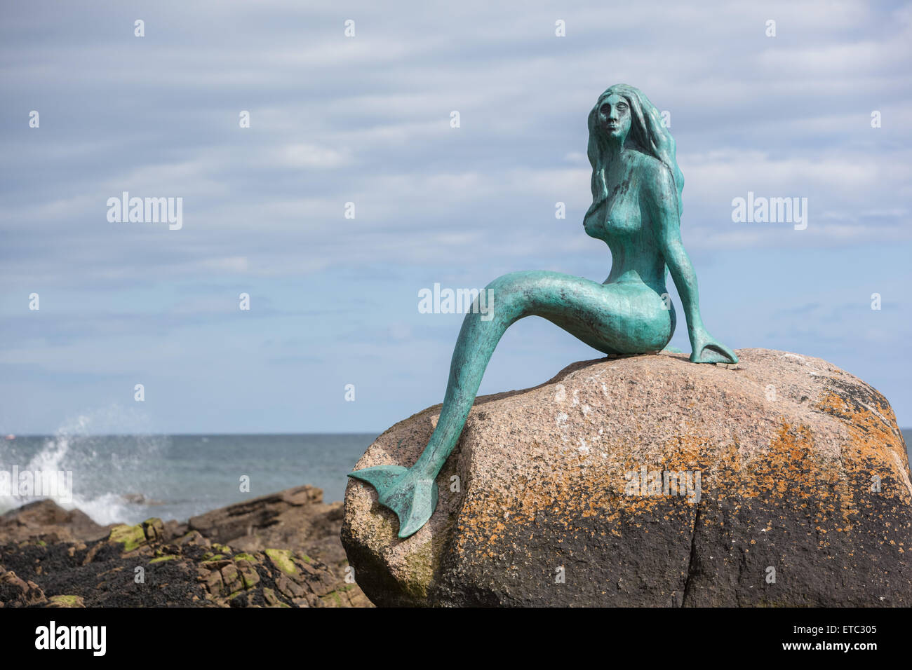 Mermaid On Rock Stock Photos & Mermaid On Rock Stock Images - Alamy