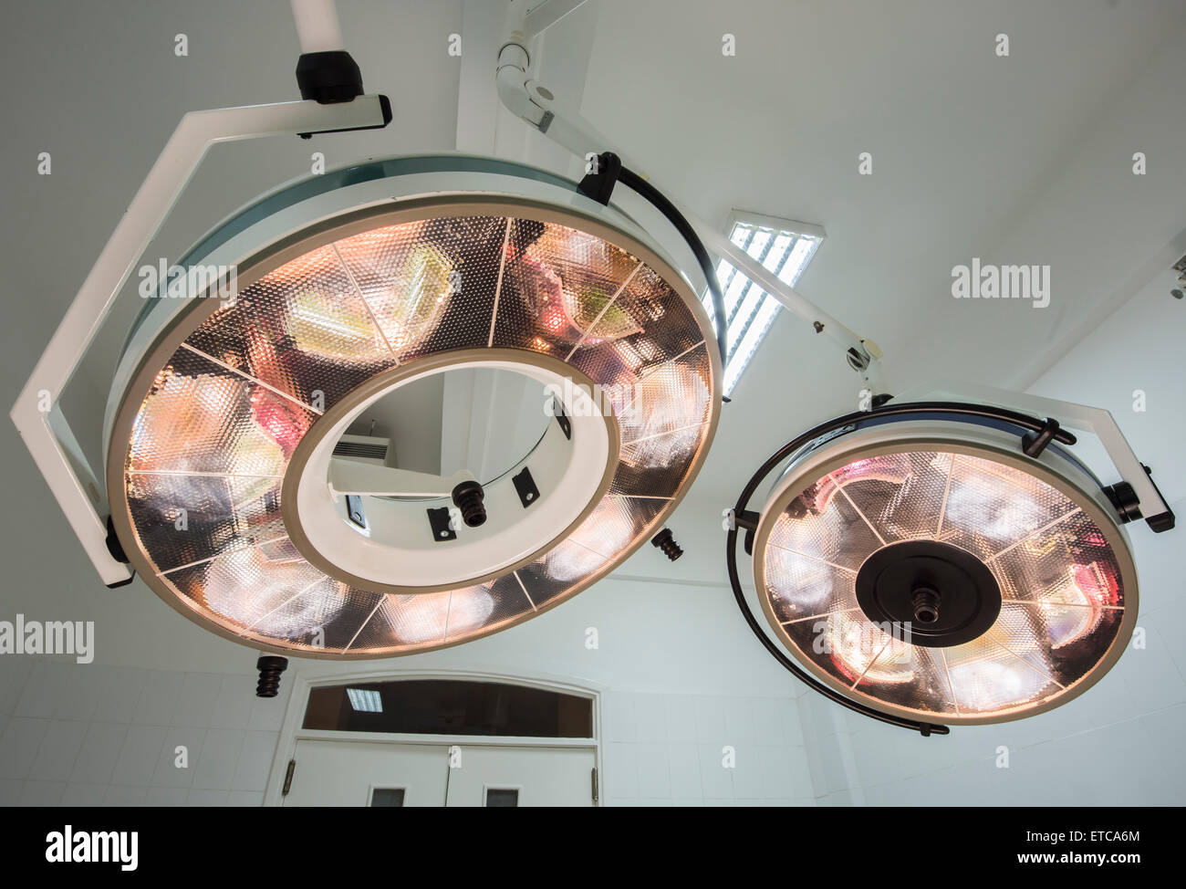 High powered circular surgery lights in a hospital operating room Stock Photo