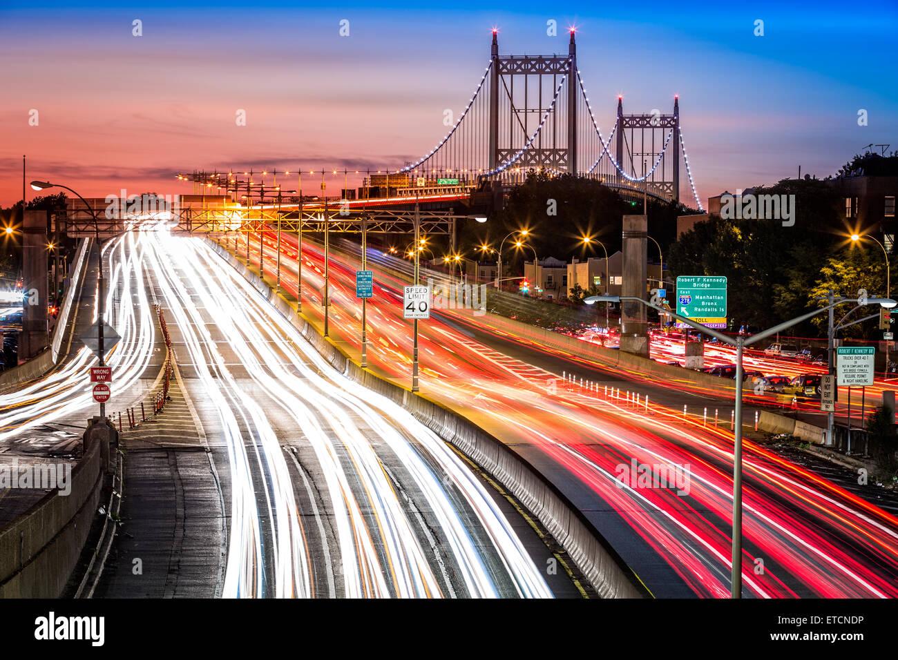 Night traffic an light trails on I-278 near RFK (aka Triboro) bridge in New York City - Stock Image