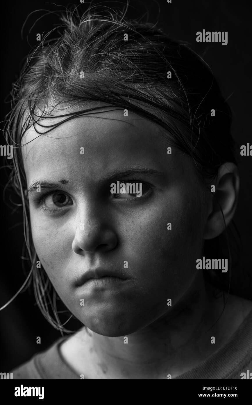 Image of an intense diry little girl. - Stock Image