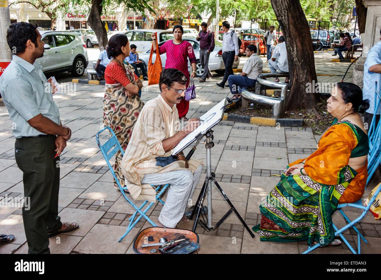 Mumbai india indian asian fort mumbai kala ghoda art plaza gallery portrait artist sketching drawing woman