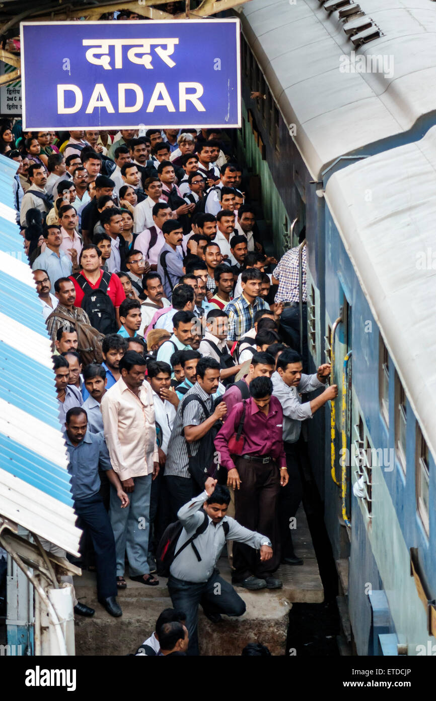 India, Indian, Asian Asians, Mumbai, Dadar Central Western Railway Line Station, train, public transportation, riders, Stock Photo