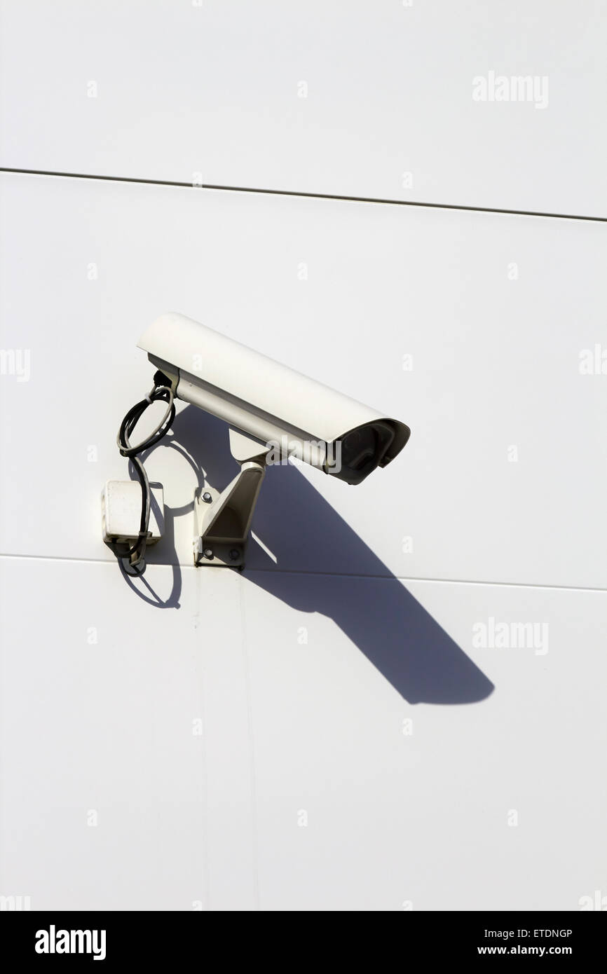 Surveillance camera on building exterior - Stock Image