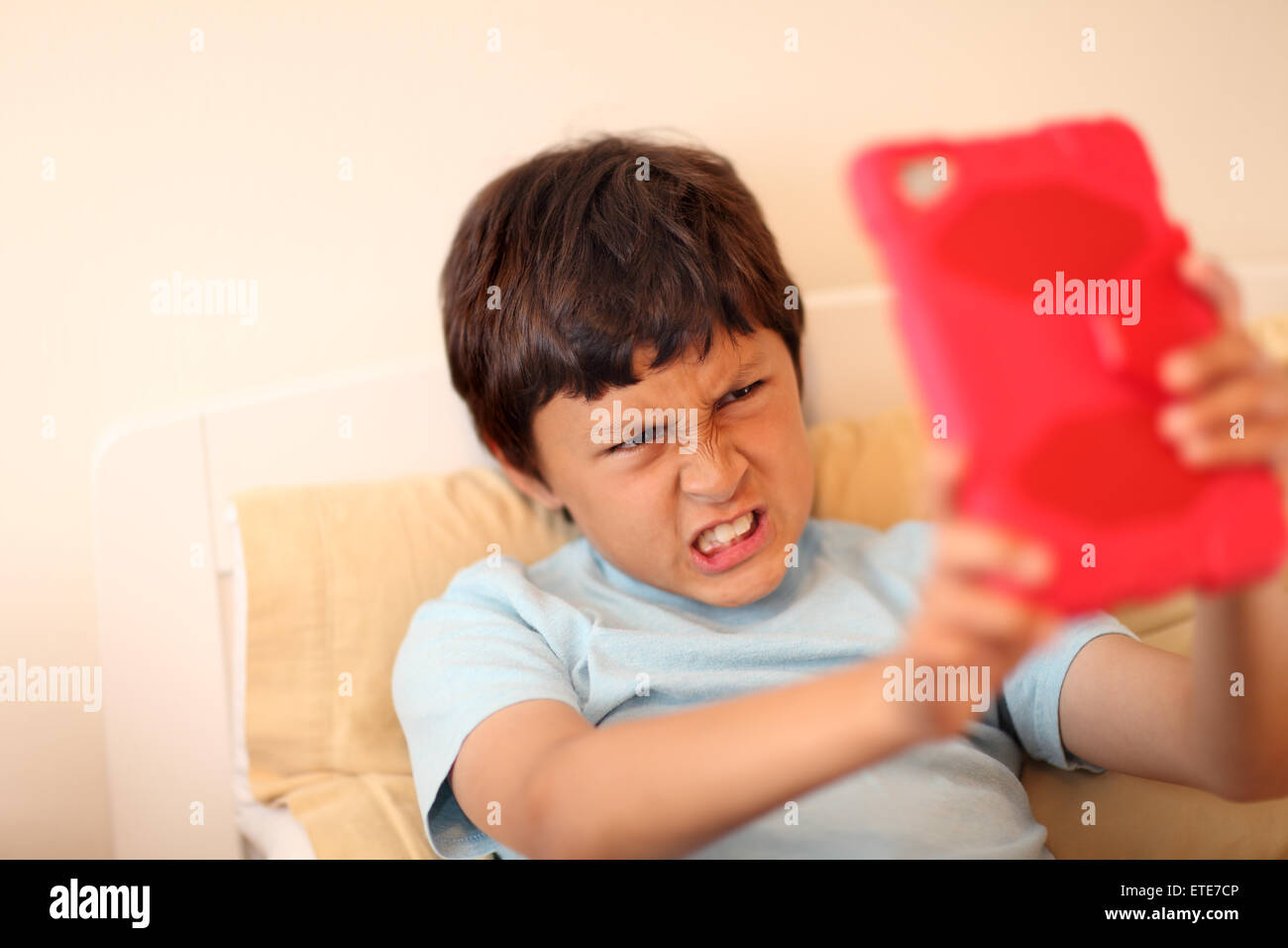 Young boy making selfie pictures with tablet computer - with shallow depth of field - Stock Image
