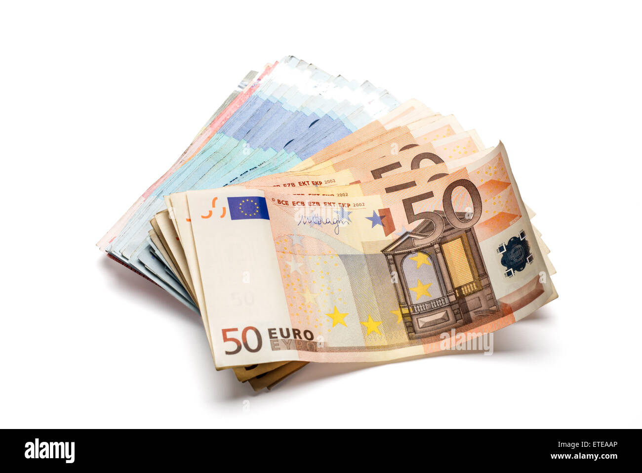 Bunch of euro banknotes of various denominations. Isolated on white - Stock Image