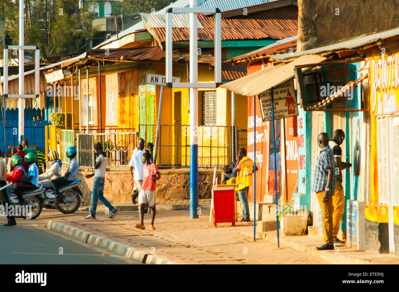 Street scene with brightly painted shops, Nyamirambo, Kigali, Rwanda - Stock Image