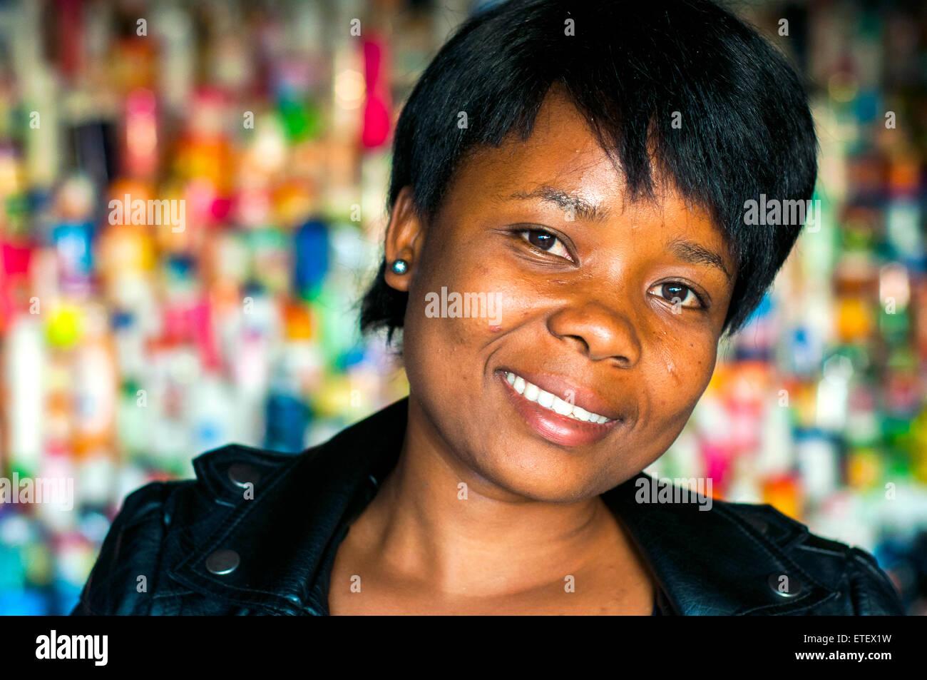 Middle-aged woman in cosmetics outlet, Nyamirambo, Kigali, Rwanda - Stock Image