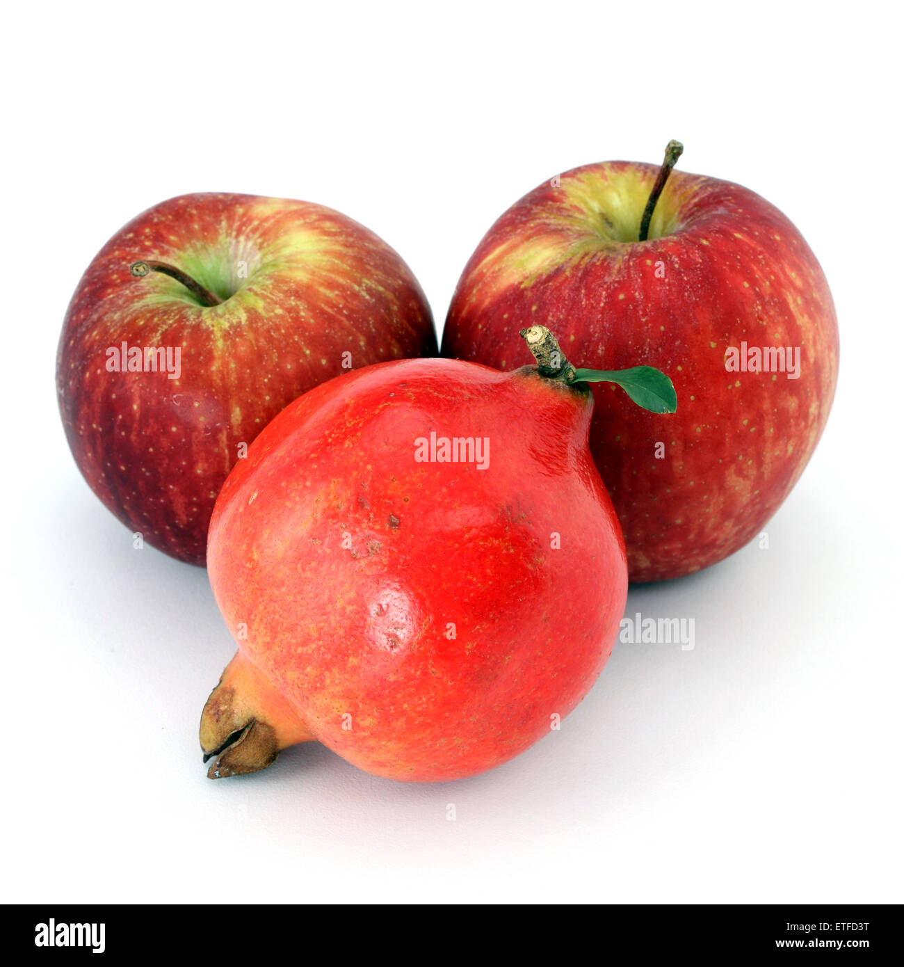 Red apples and pomegranate on white background - Stock Image