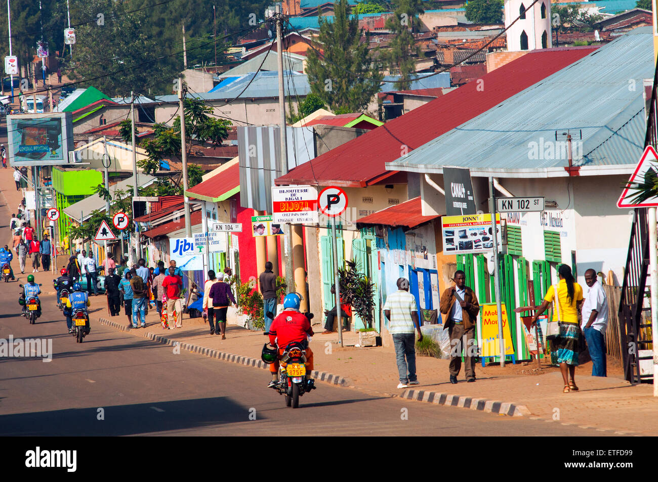 Main street scene - KN 2 Avenue - with brightly painted shops, Nyamirambo, Kigali, Rwanda - Stock Image