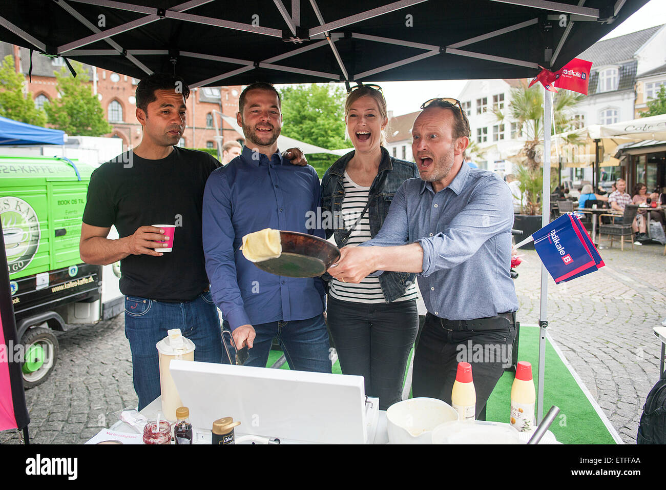 Hilleroed, Denmark, June 13th, 2015: Martin Lidegaard (Foreign Minister) (R) nearly manages to catch the pancake, - Stock Image