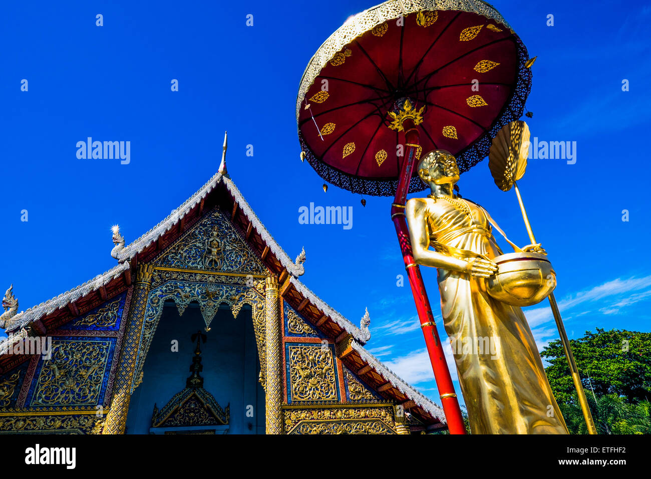 Asia. Thailand, Chiang Mai. Wat Phra Singh.Golden statue of a revered monk. - Stock Image