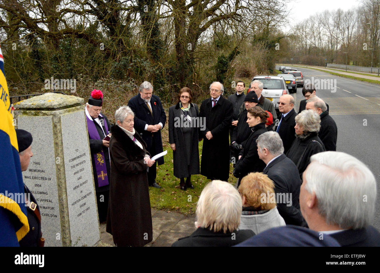 A blessing of the unmarked graves of 35 Polish servicemen takes place at Horton Cemetery. Bought by developers in - Stock Image