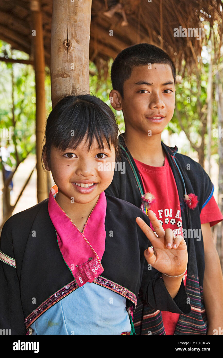 Young teens at the Hill Tribes village near Chiang Rai. - Stock Image