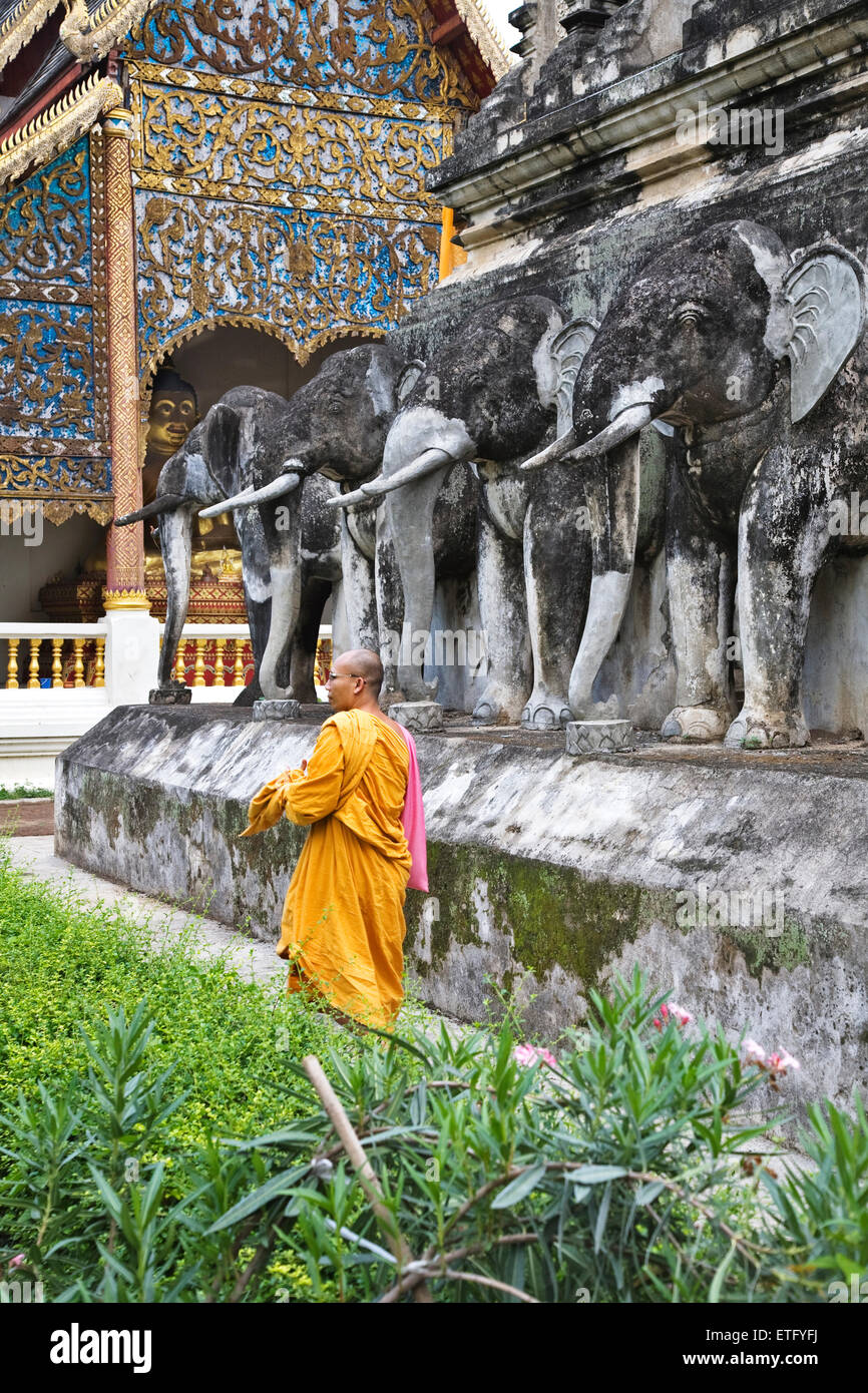 A monk near the stupa at Wat Chiang Man in Chiang Mai. It is also called Wat Chiang Mun. - Stock Image