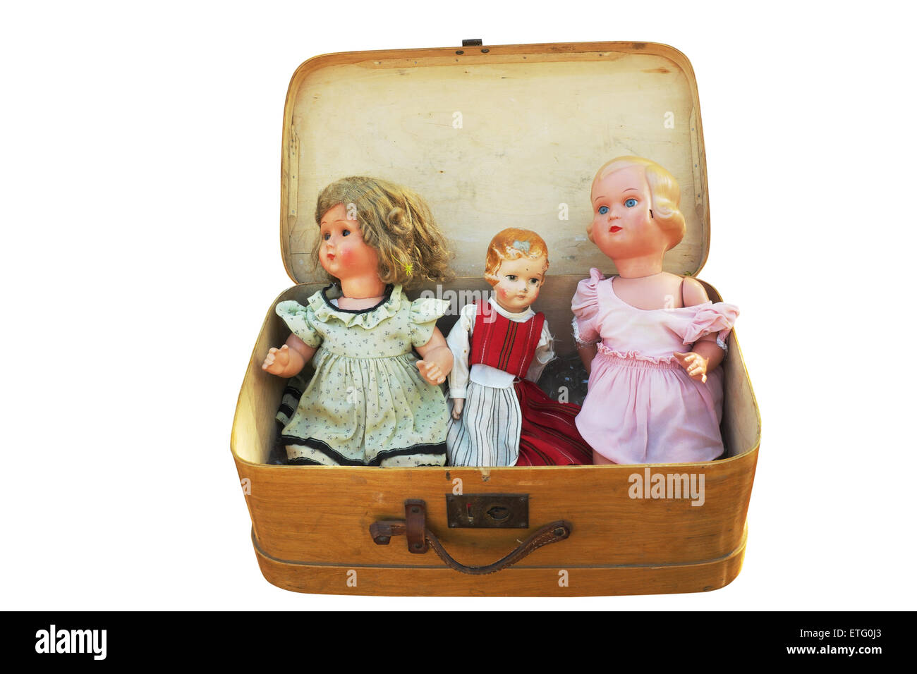 three vintage doll in an old wooden suitcase - Stock Image