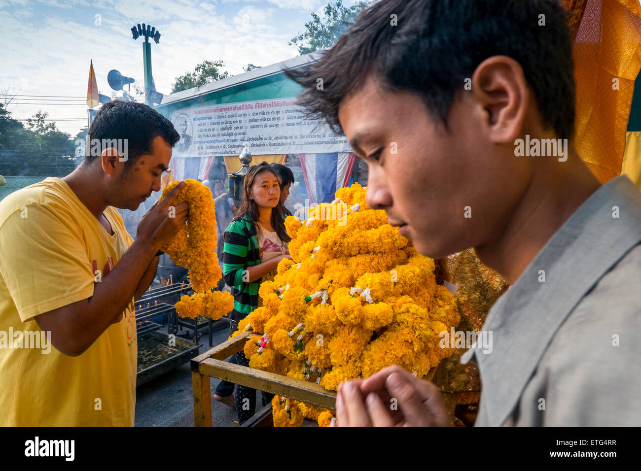 Asia. Thailand, Chiang Mai. Believer praying at the temple. - Stock Image