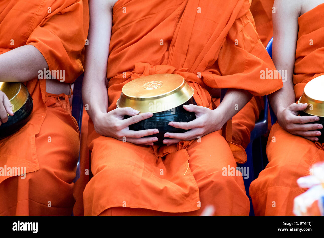 Asia. Thailand, Chiang Mai. Monks. Offering bowl. - Stock Image