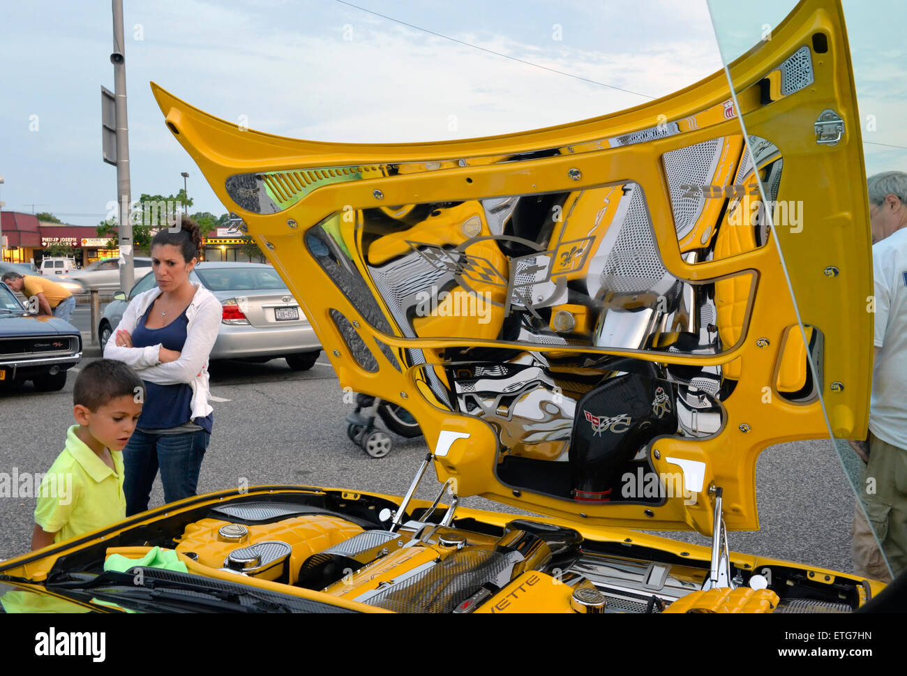 A family looks at a modified yellow 2003 Corvette 50th Anniversary model with Lamborghini doors (AKA vertical scissors doors and Lambo doors) whose ...  sc 1 st  Alamy & New York USA. 12th June 2015. A family looks at a modified yellow ...