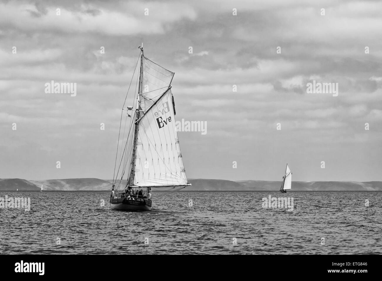 Sailing boats with full sails on a nice quiet day - Stock Image