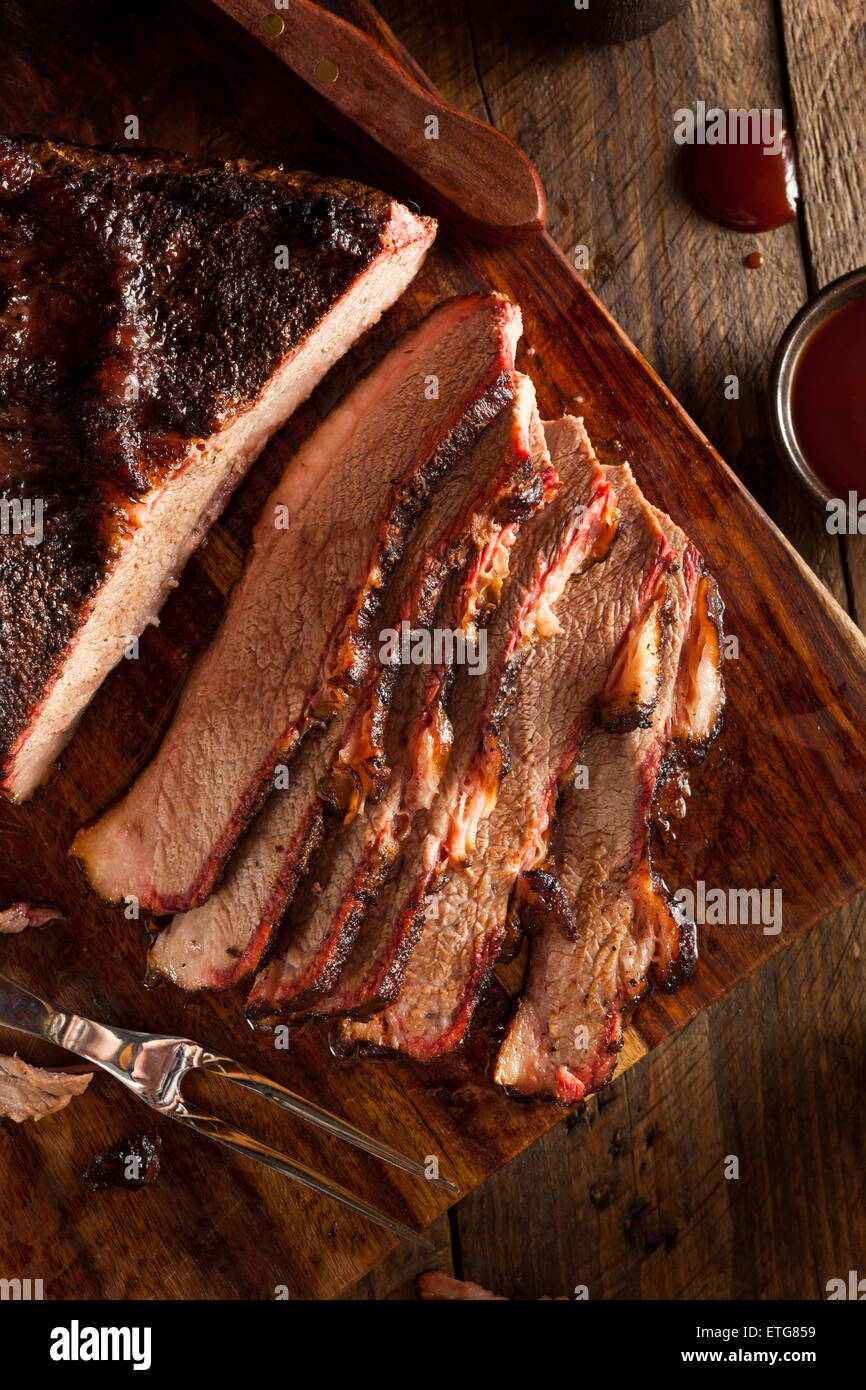 Homemade Smoked Barbecue Beef Brisket with Sauce - Stock Image