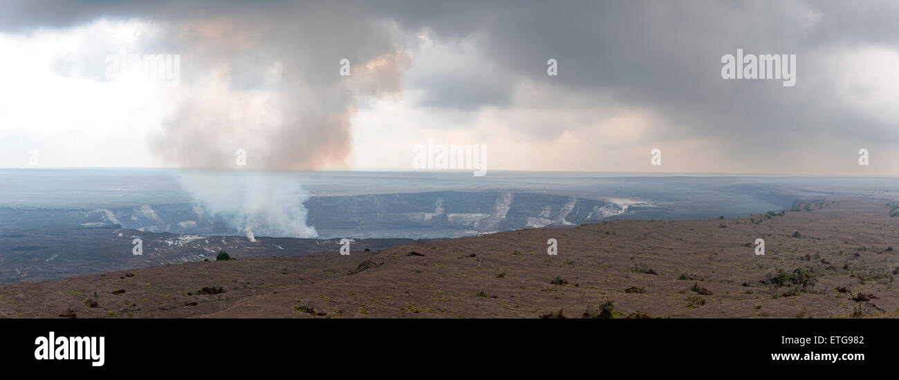 Panorama view of steam rising from Halema'uma'u Crater, Kilauea Caldera, Hawai'i Volcanoes National Park, Big Island, Stock Photo
