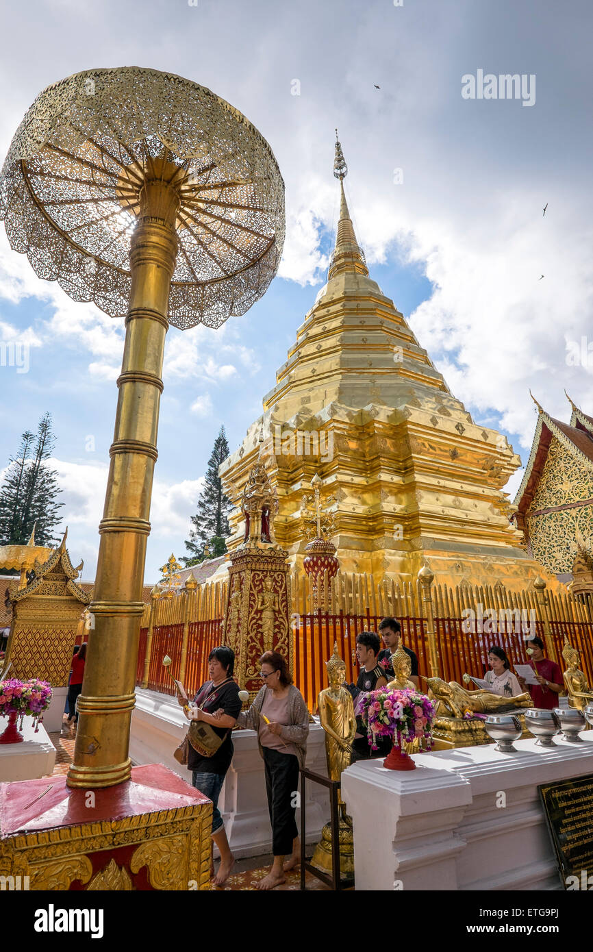 Asia. Thailand, Chiang Mai. Wat Doi Suthep. Fervent Thais being photographed in front of the effigy of King. - Stock Image