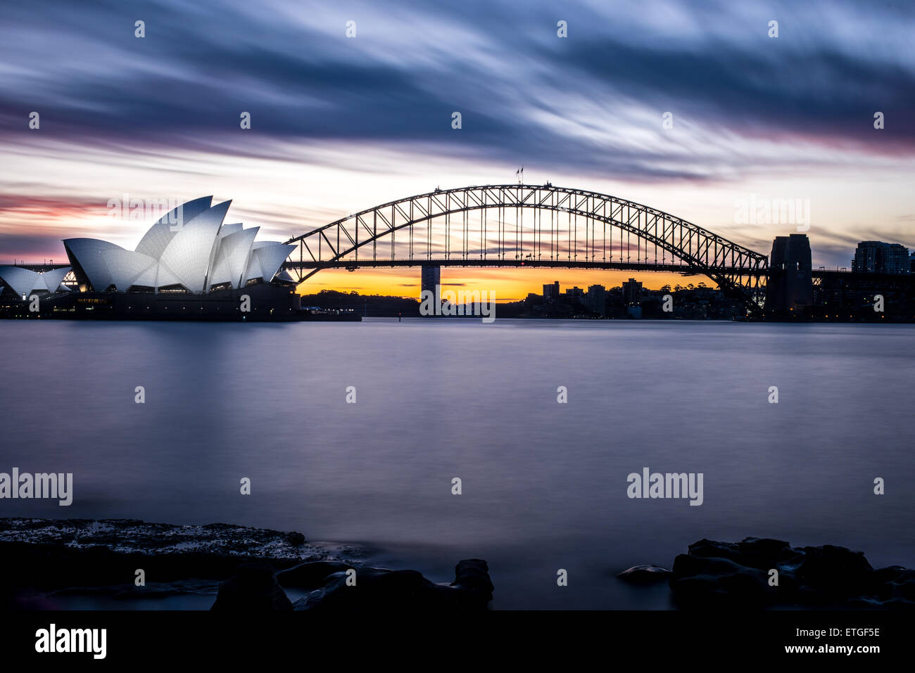 Winter sunset at the Sydney Opera House and Harbour Bridge - Stock Image