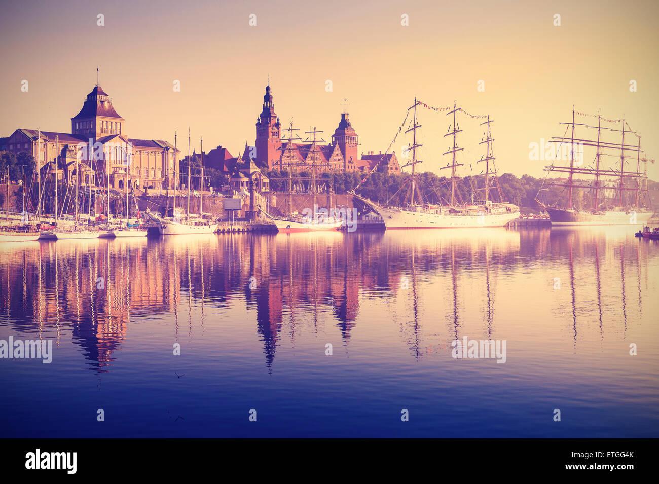 Vintage retro toned photo of sailing ships by Chrobry Embankment at sunrise in Szczecin, Poland. - Stock Image