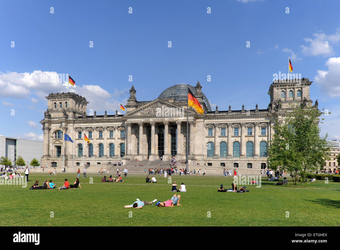 Meadow with people relaxing in front of Reichstagsgebaeude German Bundestag, Parliament Berlin, Germany, Europe - Stock Image