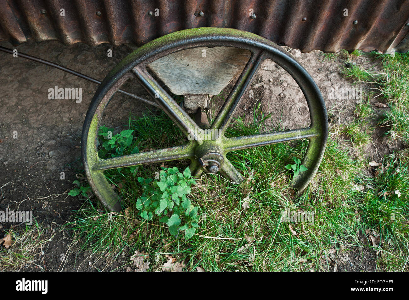 Old and rustic metal cartwheel on a shepherds hut England Europe - Stock Image