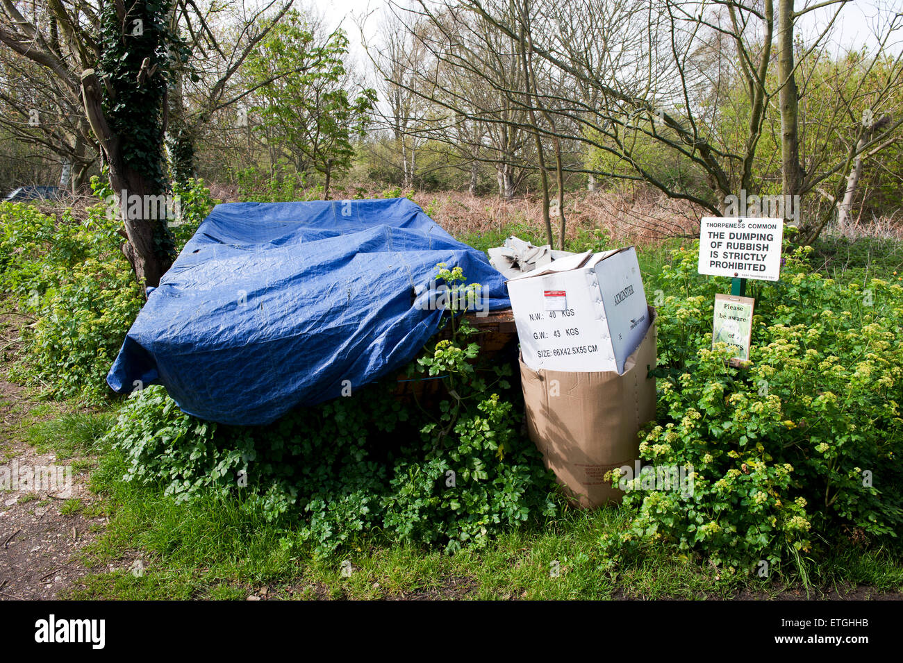 Rubbish discard at a prohibition sign Suffolk England UK Europe - Stock Image