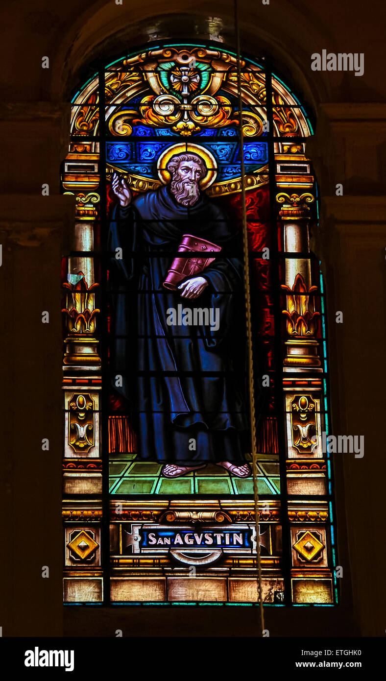Stained glass window depicting Saint Augustine of Hippo, an important Christian theologian and philosopher - Stock Image