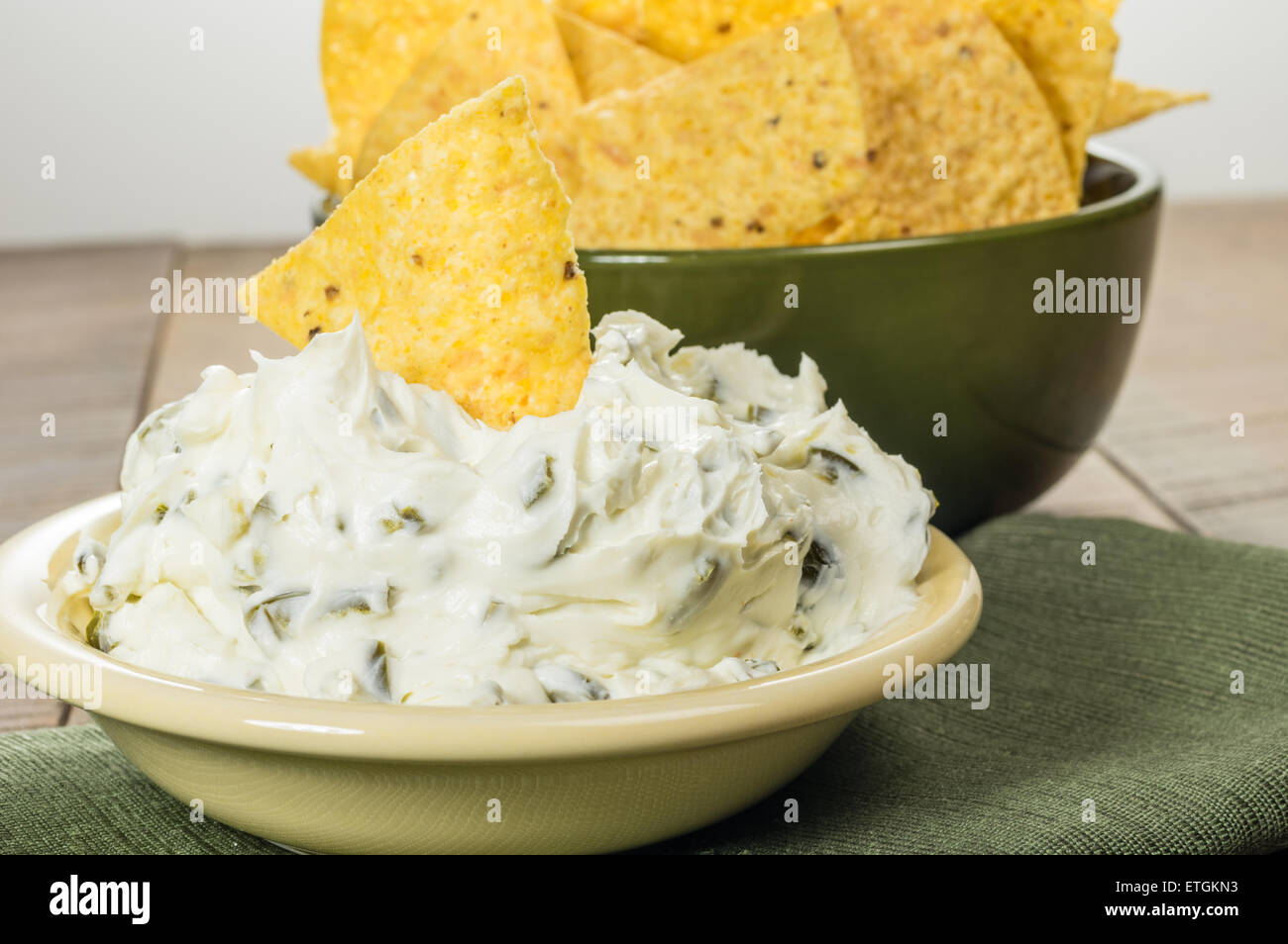 Nacho corn chips with hot pepper cream cheese dip - Stock Image