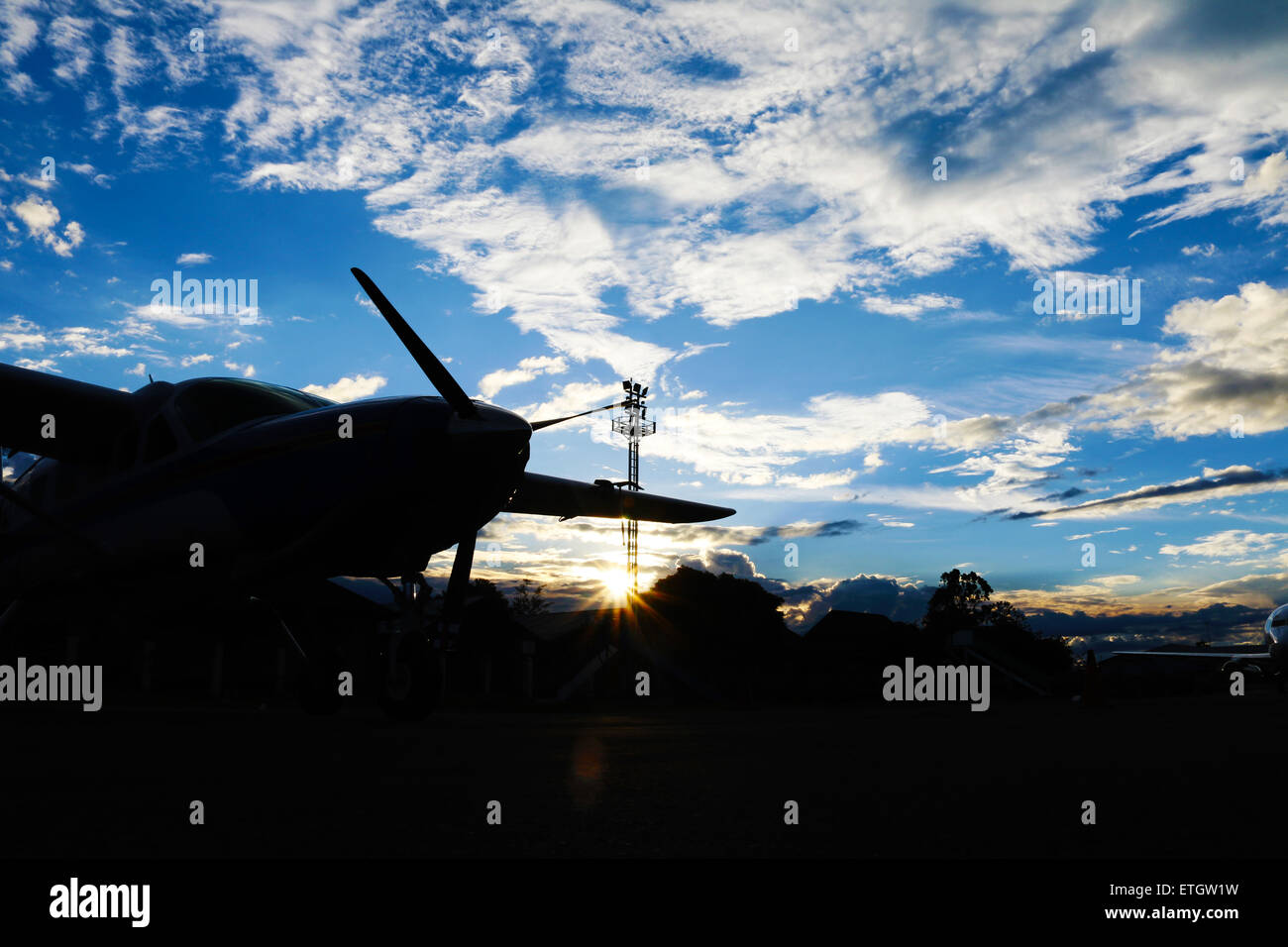 A Photo of 'Sillhouette airplane in the afternoon in Wamena airport' - Stock Image