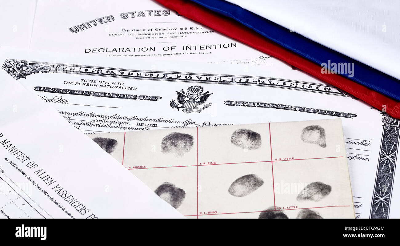Certificate of US Citizenship, declaration of intention, fingerprint card and passenger manifest with red, white - Stock Image
