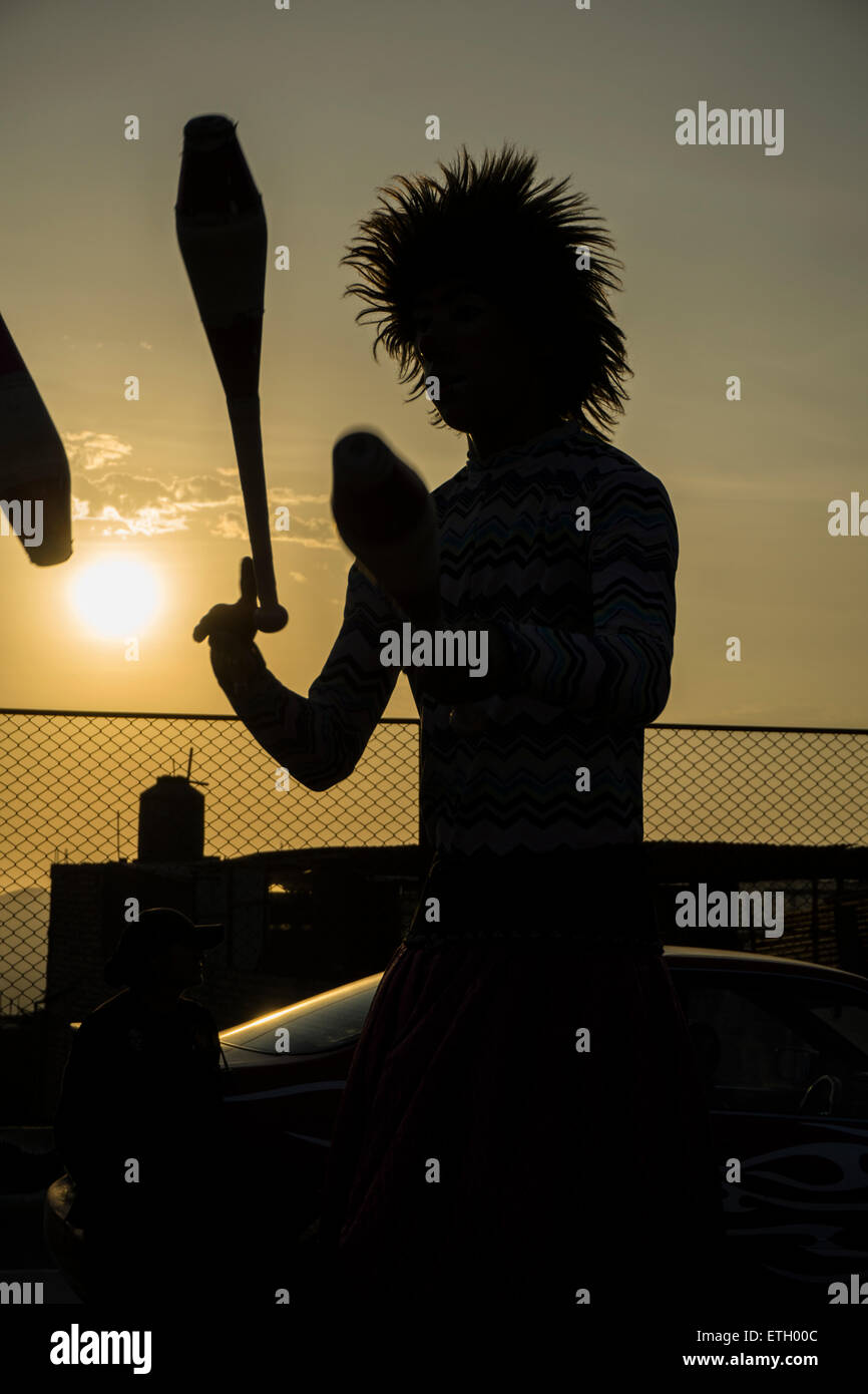 circus juggling in back light. - Stock Image