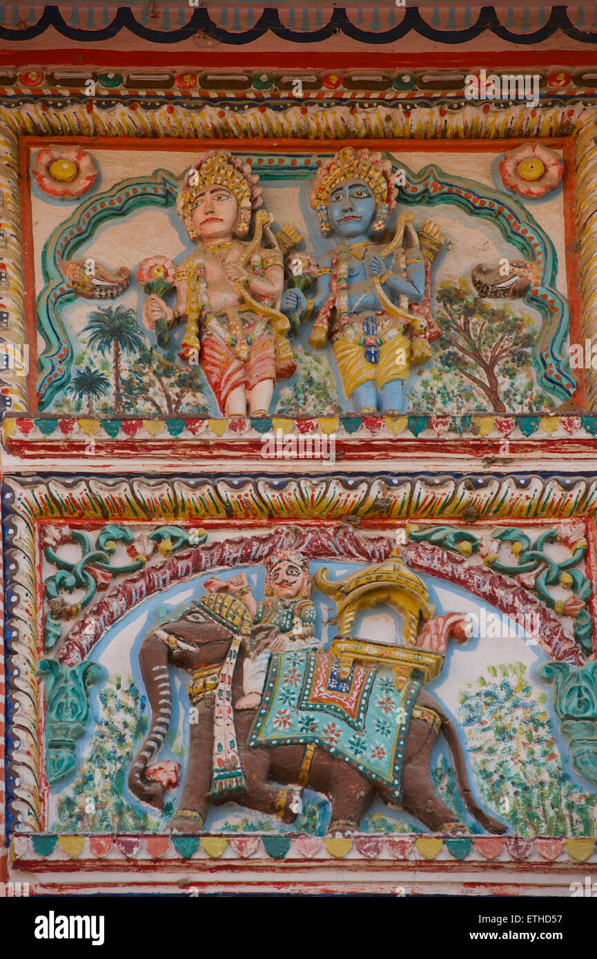Painted bas relief on a wall in Pushkar. Indian deities. Rajasthan, India - Stock Image