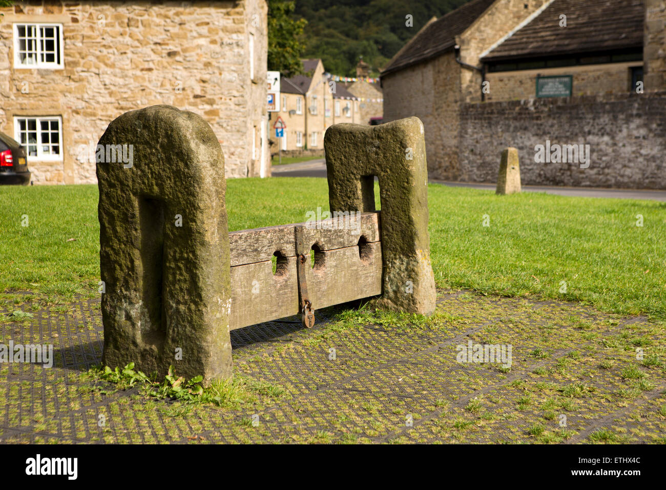 UK, England, Derbyshire, Eyam, Market Square, early C19th stone an wooden punishment stocks - Stock Image