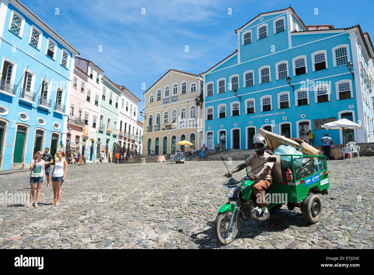 SALVADOR, BRAZIL - MARCH 12, 2015: Motorcart pulling garbage drives along the cobblestone hill in Pelourinho. - Stock Image