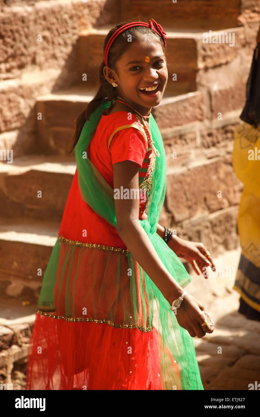 Laughing Indian girl in colourful sari. Jodhpur, Rajasthan, India Stock Photo