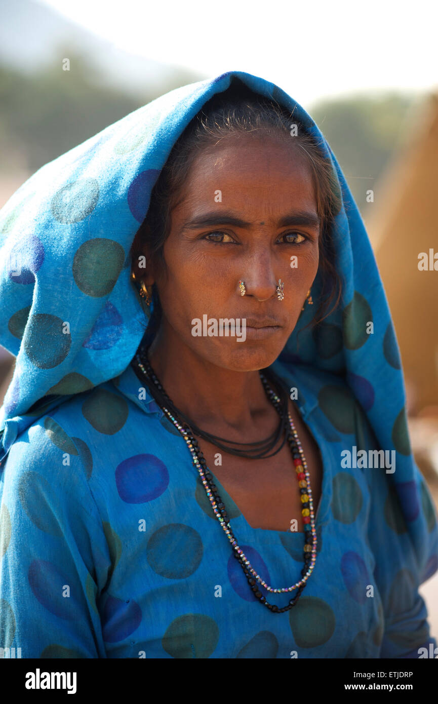 Portrait of a Rajasthani woman in blue with distinctive jewellery. Pushkar, Rajasthan, India - Stock Image